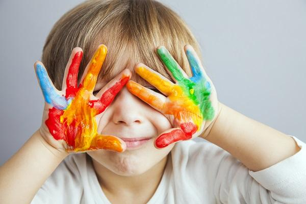 Happy foster child with paint